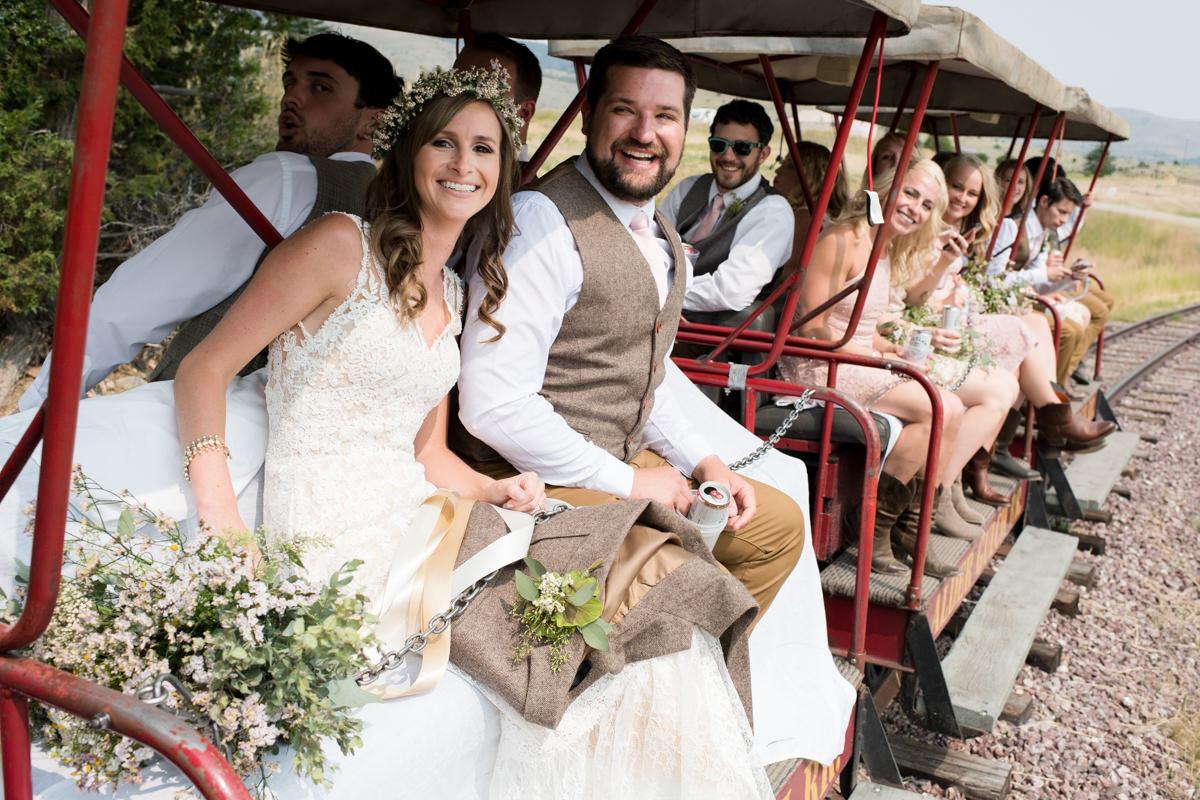 Virginia City Montana wedding day bride and groom train ride