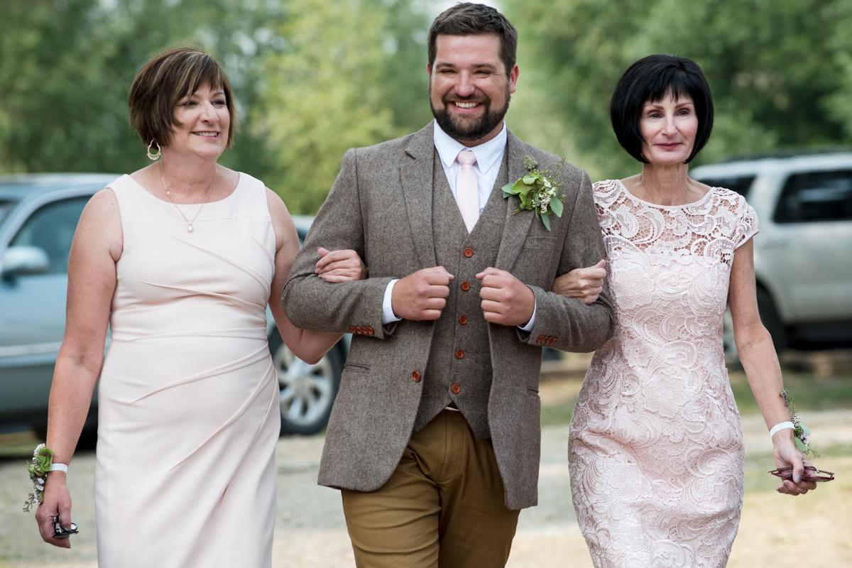 Virginia City Montana wedding day groom walk down isle