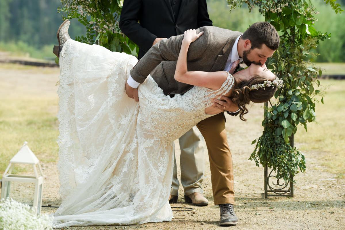 Virginia City Montana wedding day ceremony kiss