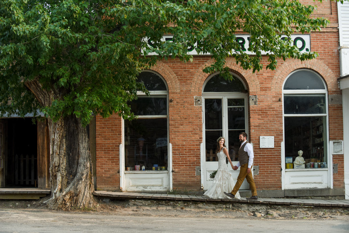 Virginia City Montana wedding day bride and groom downtown walk