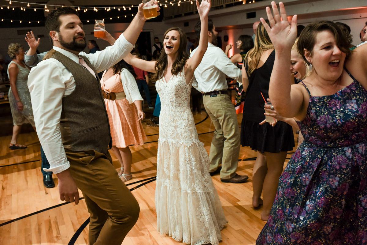 Virginia City Montana wedding day reception newlywed dancing
