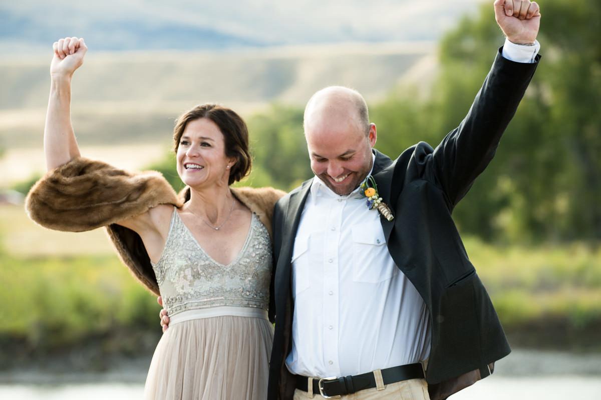 Paradise Valley Montana Wedding ceremony kiss yellowstone river