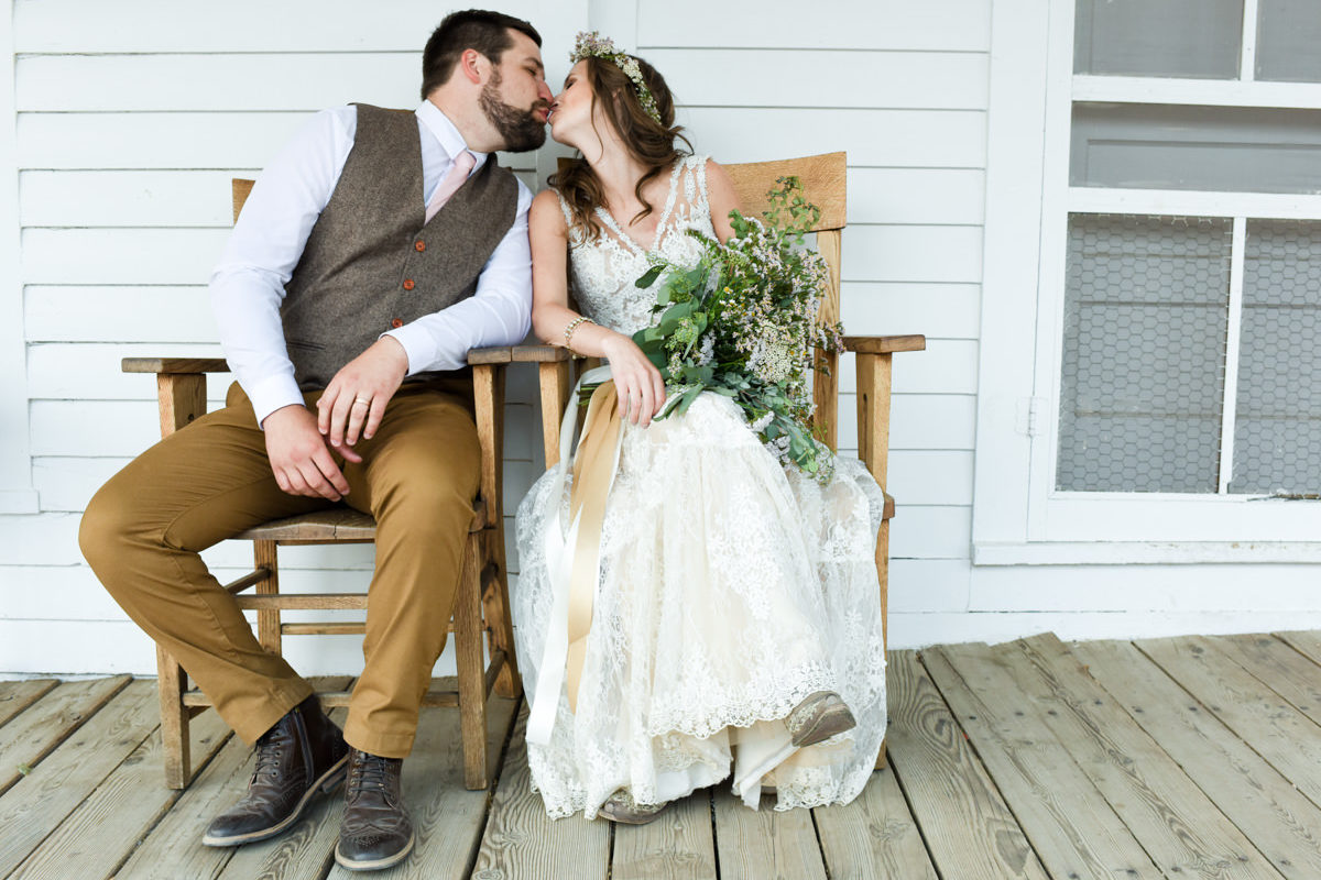 Virginia City Wedding couple porch kiss