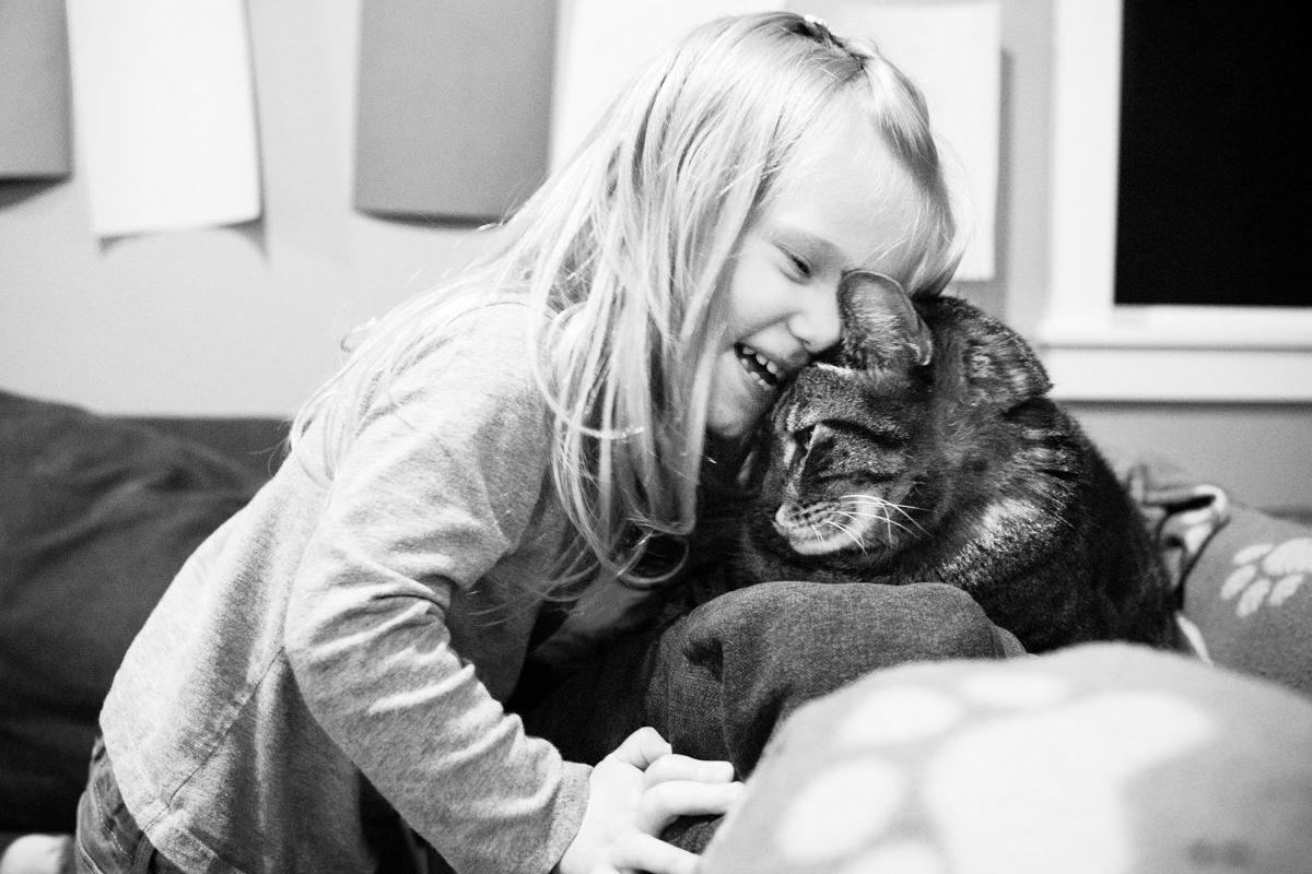 redhead girl smile pet cat portrait
