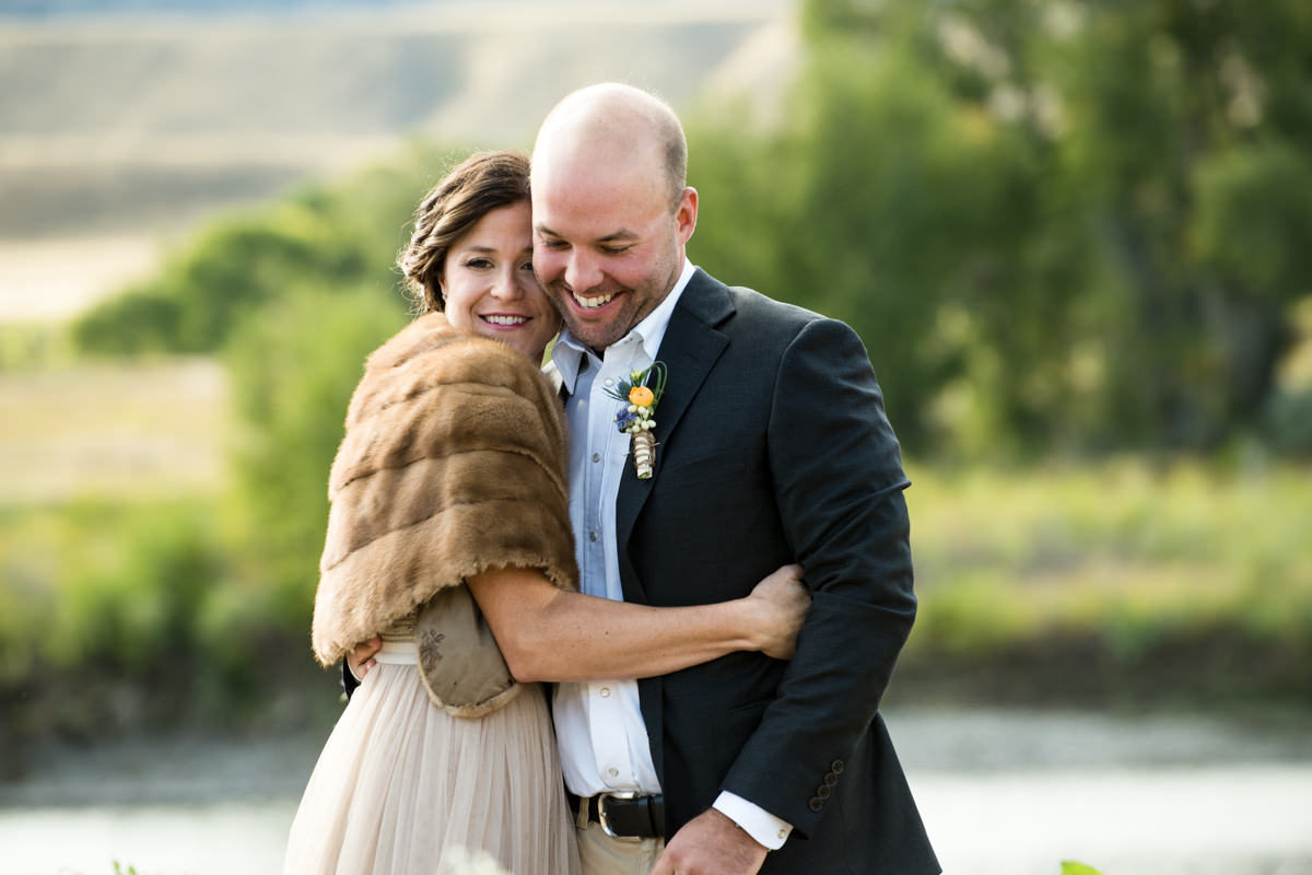 Yellowstone River wedding couple embrace smile