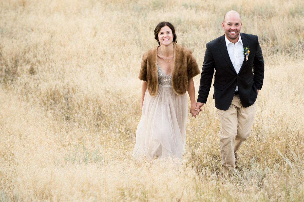 Yellowstone River wedding couple walk smile